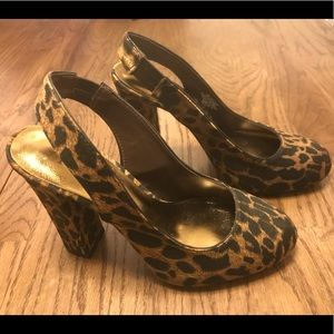 Nicole Miller chunky leopard heels with open back.